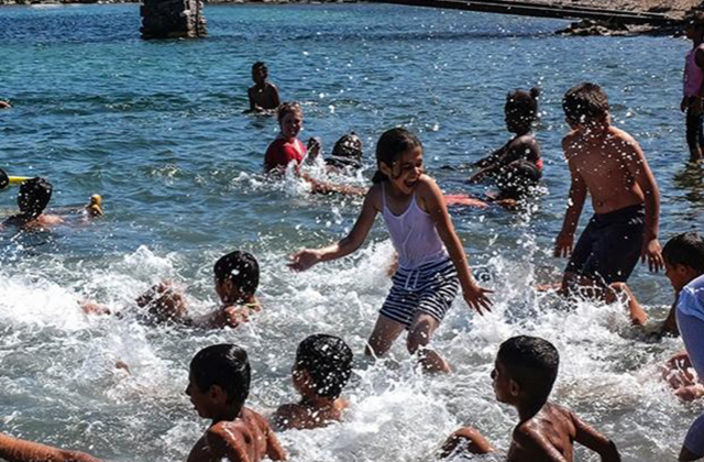 Refugee children at a swimming lesson.