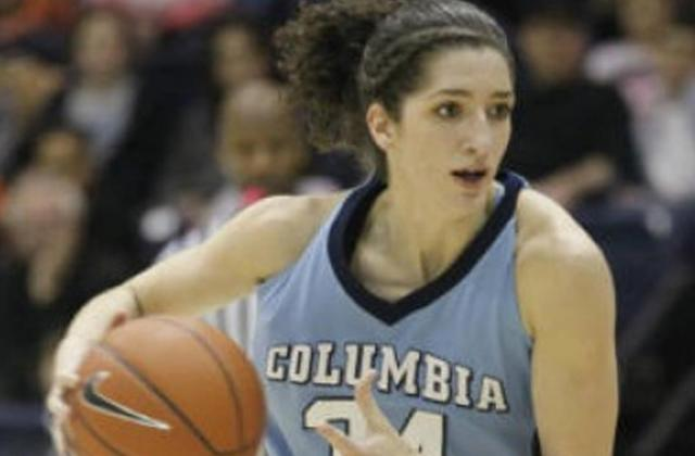 Lauren Dwyer playing basketball during her time at Columbia